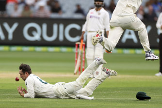 Travis Head drops a catch off India's Ajinkya Rahane on day two.
