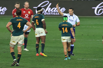 Cheslin Kolbe of South Africa is shown the yellow card.