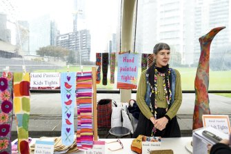 Good day: Louise O'Brien selling tights at her stall near the Arts Centre.