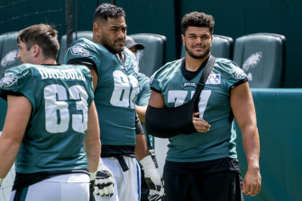 Mailata, centre, has edged ahead of Andre Dillard, right, in the Eagles' pecking order ahead of the NFL season.