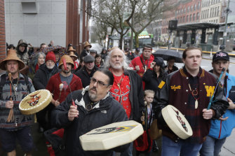 Naschio Johnson, centre, chairman of the Chinook Indian Nation, plays a drum as he leads a march to the federal courthouse in Tacoma, Washington, latt year, an effort to regain federal recognition.