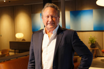 Australian billionaire Andrew Forrest has increased his holdings in salmon farmer Huon in the middle of a takeover bid by Australia and the world's largest meat processor, Brazilian company JBS.