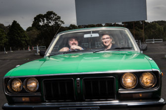 """MIFF's artistic director Al Cossar and chair Teresa Zolnierkiewicz test drive the Coburg Drive-in, one of the locations for this year's """"hybrid"""" event."""