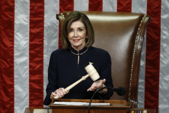 US House Speaker Nancy Pelosi holds the gavel during a vote on the two articles of impeachment.