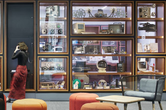The Digital Preservation Lab is visible to visitors to ACMI through the window displays in Edie Kurzer's Wall of Objects.