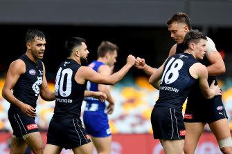 Carlton's Michael Gibbons celebrates a goal during round eight against North Melbourne.