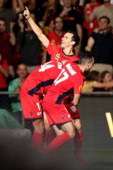 Isaias celebrates the winner.