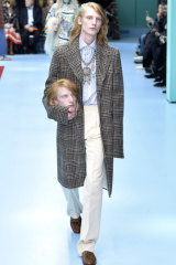 Models carried replicas of their heads at Gucci's autumn 2018 fashion show in Milan.