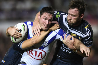 Josh Jackson of the Bulldogs is tackled by Gavin Cooper