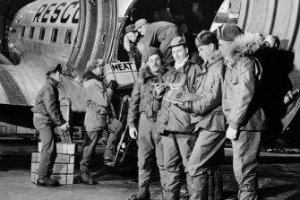 US military men unload food supplies in Thule c 1965.