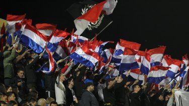 Sydney United 58 fans wave flags - without the Croatian coat of arms - at their FFA Cup clash against Sydney FC back in 2014. A ban on national flags at soccer games in Australia is set to be lifted.