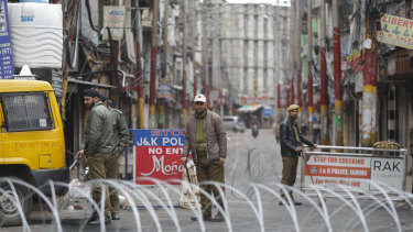 Indian police men keep vigil during the fourth consecutive day of curfew in Jammu,  Kashmir state, India,