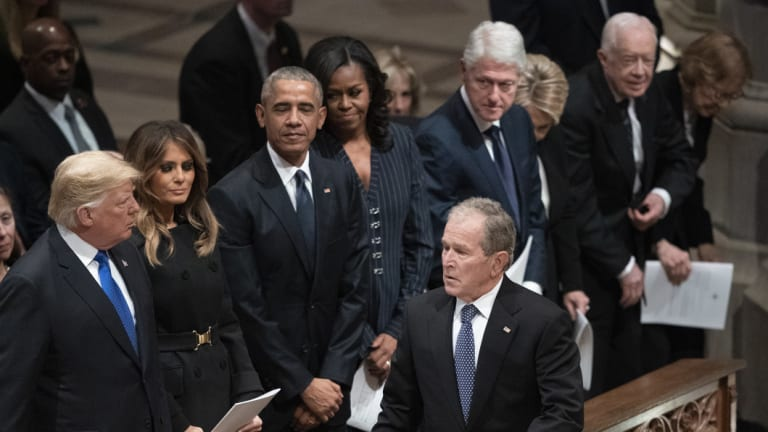 Former president George W. Bush walks to his seat after greeting President Donald Trump, first lady Melania Trump, former president Barack Obama, Michelle Obama, former president Bill Clinton, former secretary of state Hillary Clinton, former president Jimmy Carter and Rosalynn Carter during a state funeral for former president George H.W. Bush.