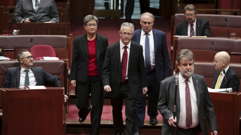 ACT Senator David Smith, flanked by senators Penny Wong and Don Farrell, has been sworn-in.