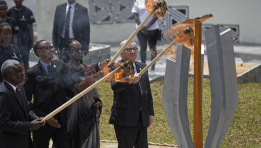 Chairperson of the African Union Commission Moussa Faki Mahamat, Rwanda's President Paul Kagame, Rwanda's first lady Jeannette Kagame, and President of the European Commission Jean-Claude Juncker light the flame of remembrance at the Kigali Genocide Memorial in Kigali on Sunday.