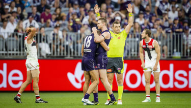 The Dockers celebrate their narrow win over St Kilda.