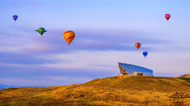 Balloons rising over the Margaret Whitlam Pavilion at the National Arboretum.