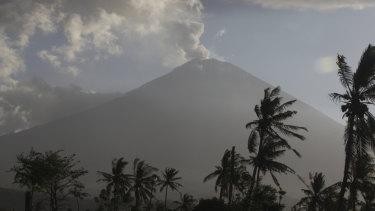 Mount Agung spewing ash and smoke in an during an eruption on July 5, 2018.  The Easter Sunday 2019 eruption has not impacted flights.