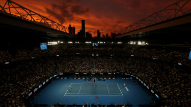 Red sky night: Sunset over Rod Laver Arena in Melbourne during tonight's third-round match.