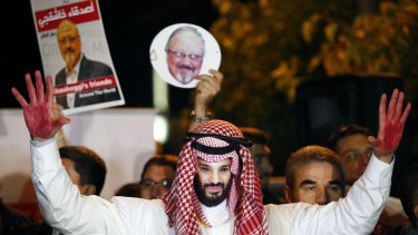 An activist wearing a Bin Salman maks during a candlelight vigil for Saudi journalist Jamal Khashoggi outside Saudi Arabia's consulate in Istanbul.