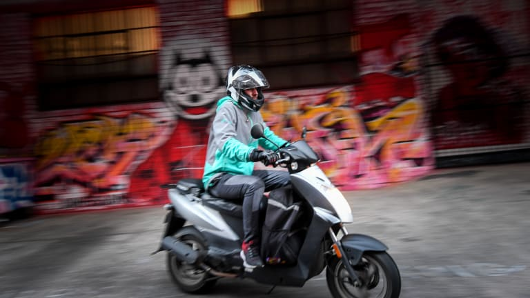A delivery driver leaves Deliveroo's dark kitchen.