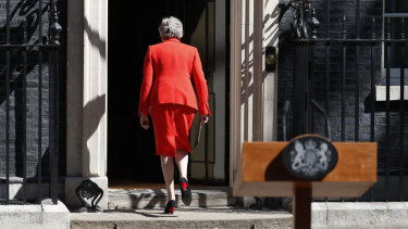 British Prime Minister Theresa May walks away after making a speech in the street outside 10 Downing Street.