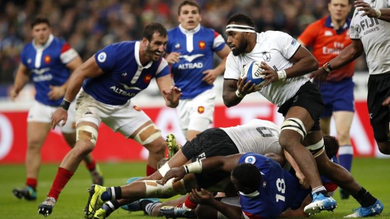 Flying Fijian: Semi Kunatani runs the ball at Stade de France in Paris.