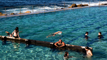 Swimmers enjoy the winter sunshine at Bronte Pool, Sydney.