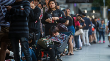 Lining up for bargains across Australia: Shoppers at a David Jones queue on Wednesday morning.