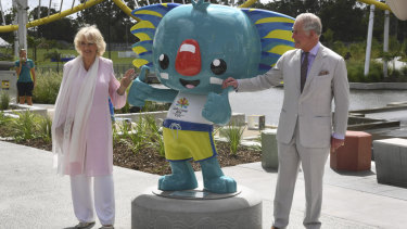 Camilla and Prince Charles pose with the Commonwealth Games mascot, Borobi.