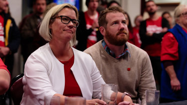Hannah Beazley, Labor candidate for Swan and her husband Andrew Canion watch Bill Shorten's concession speech on TV at the Belmont Sports and Recreation Club.