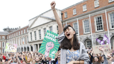 A woman at Dublin Castle reacts to the vote to repeal the 8th amendment of the Irish constitution, which banned abortion.