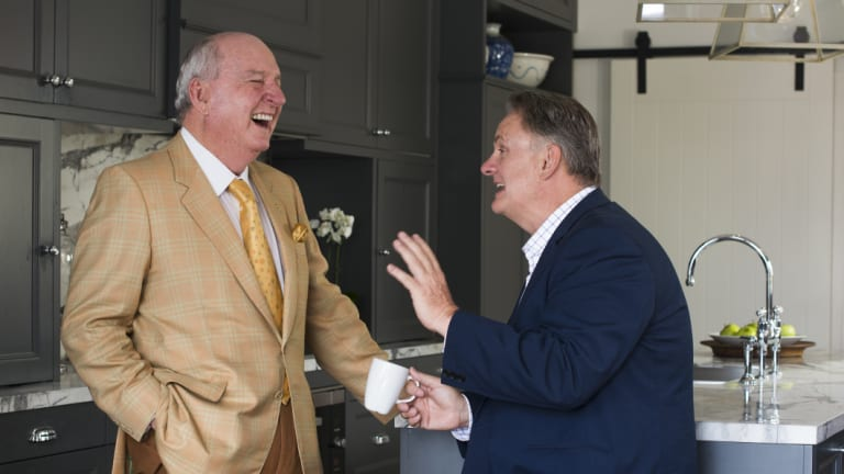 Alan Jones and Mark Latham enjoy a chat in the kitchen.