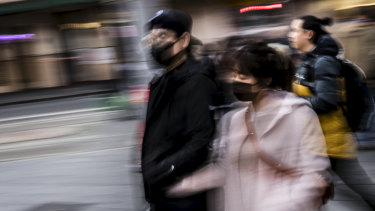 People wearing face masks during flu season in Sydney's Haymarket.
