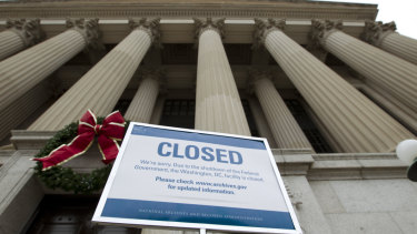 A closed sign is displayed at The National Archives entrance in Washington.