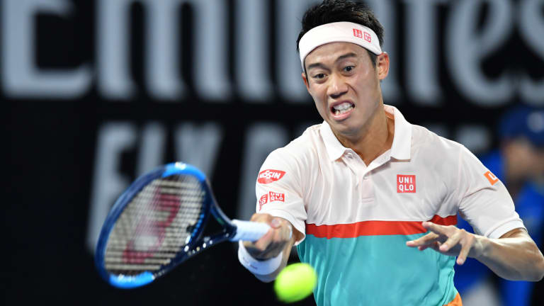 On a roll: Kei Nishikori blasts a forehand during his straight-sets win against Grigor Dimitrov on Thursday night.