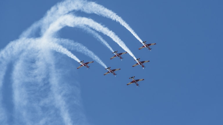 RAAF Roulettes put on a display over the lawns of Parliament House.