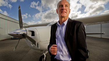 Rob Newman, director of Nearmap, standing next to one of the planes used for mapping.