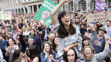 Ecstatic 'Yes' vote supporters celebrate in Dublin.