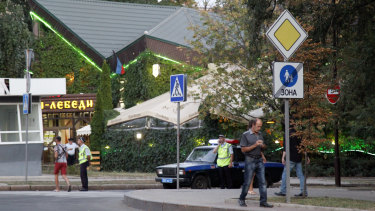 Policemen block traffic close to the site of the murder of Alexander Zakharchenko in Donetsk on Friday.