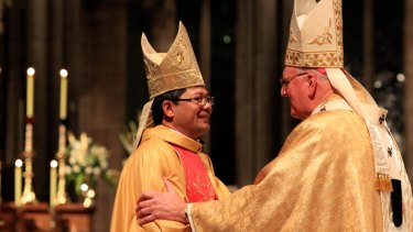 Vincent Long Van Nguyen being inducted  as a Catholic priest at St Patrick's Cathedral in 2011.
