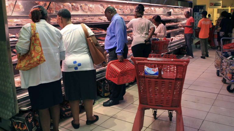 Zimbabweans buy various goods after some shops opened in Harare on Friday.