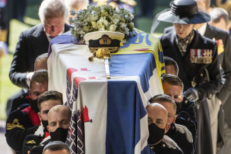 Pall bearers carry Prince Philip's coffin into St George's Chapel.