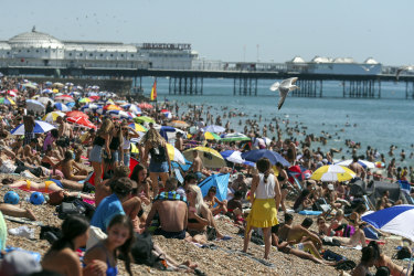 People crowd onto the beach at Brighton, England, Friday August 7, 2020. The UK could see record-breaking temperatures with forecasters predicting Friday could be the hottest day of the year.  (Steve Parsons/PA via AP) Gebicki column tra28-online-europe