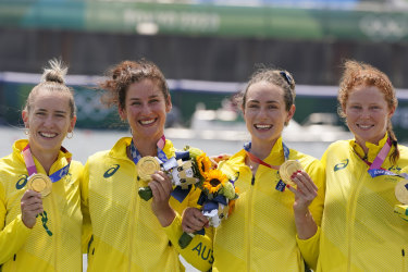Lucy Stephan, Rosemary Popa, Jessica Morrison and Annabelle McIntyre pose with the spoils of victory.