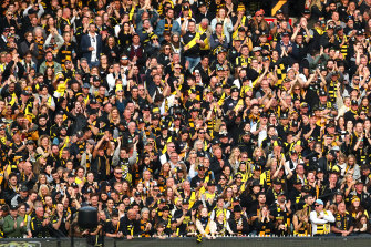 MELBOURNE, AUSTRALIA - SEPTEMBER 28: Richmond Tigers fans celebrate winning the premiership during the 2019 AFL Grand Final match between the Richmond Tigers and the Greater Western Sydney Giants at Melbourne Cricket Ground on September 28, 2019 in Melbourne, Australia. (Photo by Kelly DefinaAFL Photos/via Getty Images ) CROWD PRE-MATCH ENTERTAINMENT