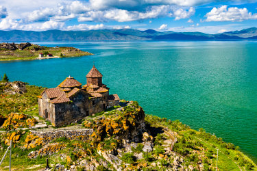 Aerial view of Hayravank monastery on the shores of lake Sevan in Armenia satapr4covercoverstory GOOD RIDDANCE 2020 ; text by Ben Groundwater ; iStock ^^^ REUSE PERMITTED ^^^