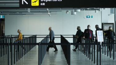People check-in for flights at Melbourne Airport.