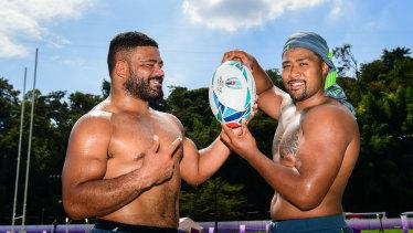 Cousins: Tolu Latu and Folau Faingaa are battling out to start for the Wallabies against Fiji on Saturday.