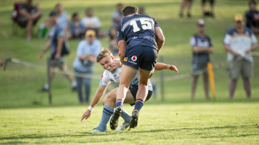 Where there's a Will: Will Harrison tackles Tom Banks in the Waratahs' pre-season trial against the Brumbies in Goulburn this year.
